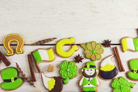 Gingerbreads cookies for Patricks day on white wooden background