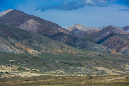 Different colored mountains in near Mongolian Altai mountains, Russia.