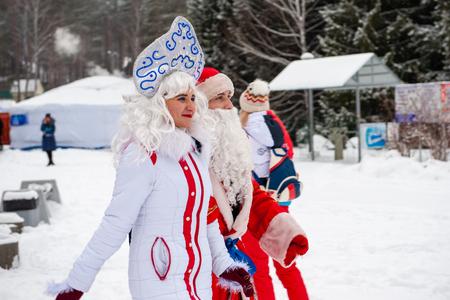 BYURIZOVAYA KATUN. ALTAISKIY KRAI. WESTERN SIBERIA. RUSSIA - DECEMBER 1, 2018: Father Frost and Snow Maiden on folk winter holiday called the Altaiskaya Zimovka holiday - the first day of winter on December 1, 2018 in Altayskiy krai, Siberia, Russia.
