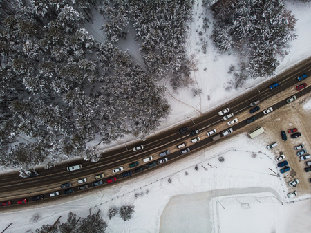 Aerial view of a road with traffic in winter landscape Фото со стока