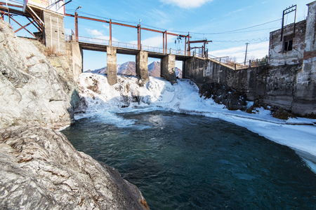 Old Hydro power station in Chemal, Altai,Siberia, Russia. Winter sunny day. A popular tourist place