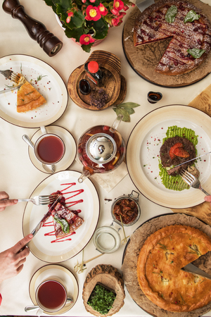 Top view on the table with different healthy food during meeting of three friends Reklamní fotografie