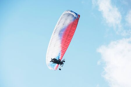 Paragliding in the mountains. Paragliders in fight in the mountains, extreme sport activity.