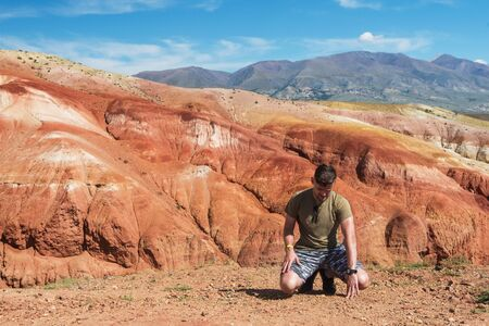 Man in Valley of Mars landscapes in the Altai Mountains, Russia
