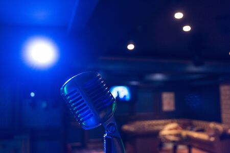 Retro music microphone on stage in a night club. Show or performance concept 스톡 콘텐츠