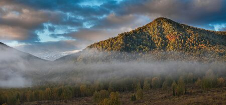 Panoramic picture of sunrise in Altai mountains nature reserve. The beginning of autumn, September