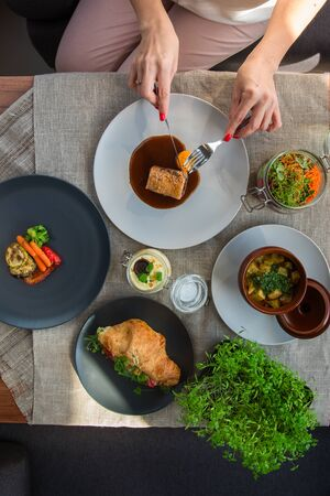 Top view of business lunch - different tasty dishes on the table table from high view angle.
