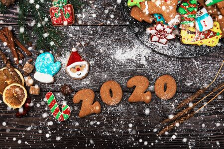 Different ginger cookies for new 2020year holiday on wooden background, xmas theme