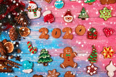 Gingerbreads for new 2020 year on wooden background, xmas theme