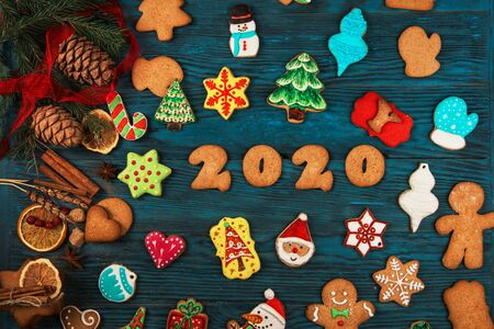 Gingerbreads for new 2020 year holiday on wooden background, xmas theme