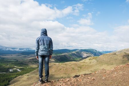 Man watching to glacier in Altai mountains. Resting in mountains or global warming concept