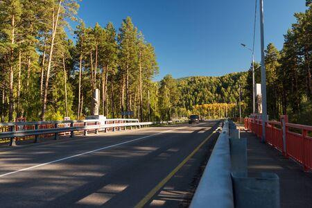 Bridge over a mountain river Katun, Altai Mountains, Russia.