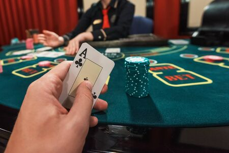 Casino, gambling and entertainment concept - poker game, point of view