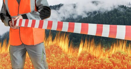 Firefighter blocks access into burning forest