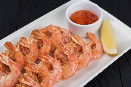 Fried shrimps with sauce and lemon on plate Reklamní fotografie - 137799790