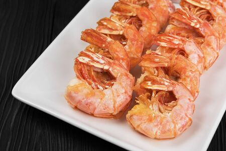 Fried shrimps with sauce and lemon on plate