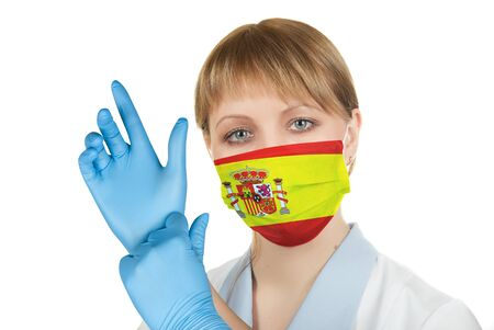 Closeup of a female healthcare professional nurse wearing a protection mask with Spain flag Stock Photo
