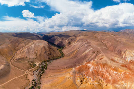 Aerial drone view of the textured yellow and red mountains resembling the surface of land, nature landscape in popular tourist location called Mars, near the border with Mongolia, Chagan-Uzun, Altai Republic, Russia