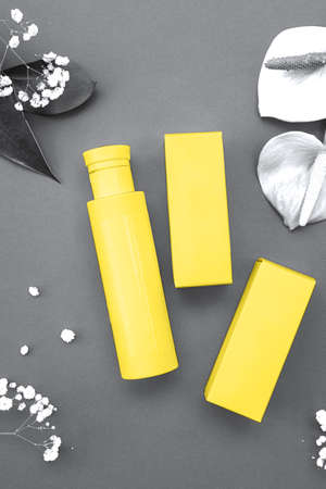Ultimate Gray and Illuminating yellow concept. Makeup cosmetic products, flat lay, top view.