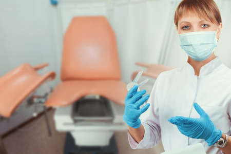 Female gynecologist in protective mask