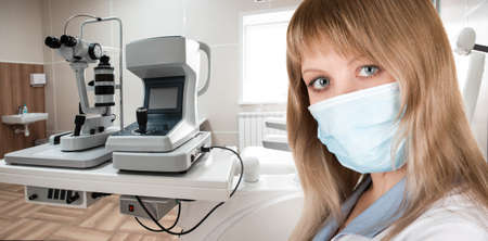 Female ophthalmologist in protective mask 写真素材