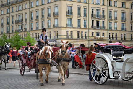 panache: Tourists and visitors ride on a horsedrawn carriage in Berlin. Germany Editorial