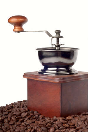 Coffee mill on the background of coffee beans