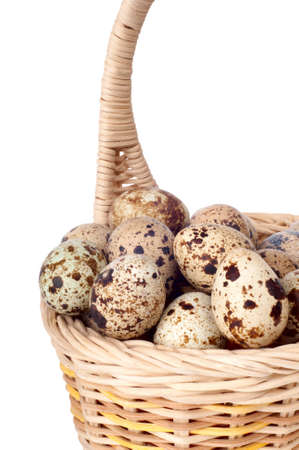 quail eggs in a basket isolated on a white background Stock Photo