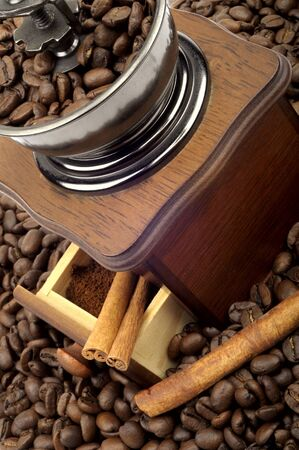 Coffee mill on the background of coffee beans photo