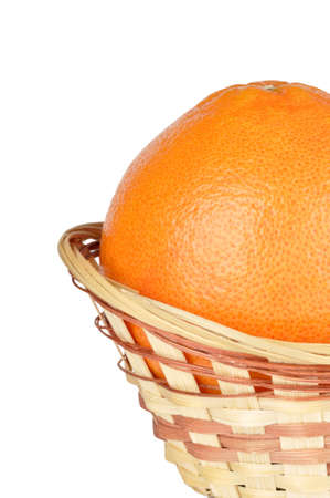 grapefruit in the basket isolated on a white background