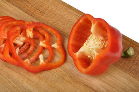 red pepper sliced on a worn cutting board