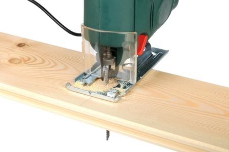 sawing wood board electric jigsaw
