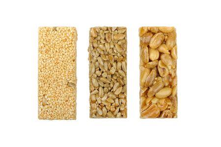 gozinaki: gozinaki of sunflower seeds sesame seeds and peanuts isolated on a white background