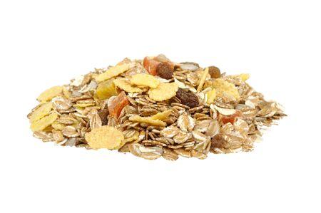 muesli: pile of muesli  isolated on a white background