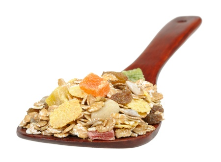 muesli on a wooden spoon isolated on white background Stock Photo