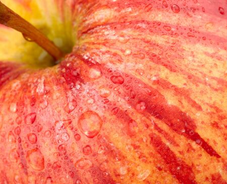 background of a red apple with water drops