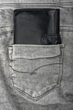 old leather wallet in the old gray jeans photo