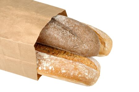 rye bread and wheat bread in paper bag isolated on white background photo