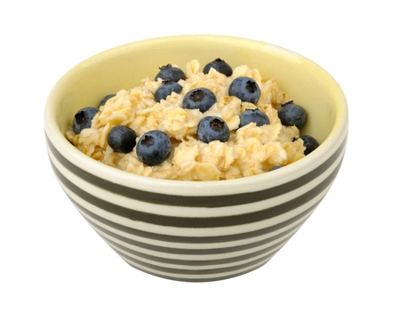Oatmeal with blueberries in a bowl isolated on white background