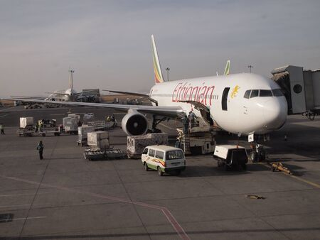 Ethiopian airlines standing on tarmac at airport