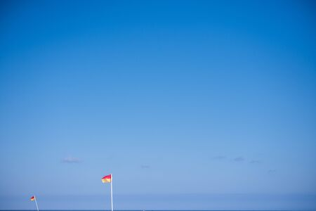 Flags on local beach inducating safe swimming area
