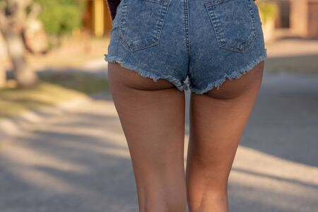 Young woman wearing tight shorts