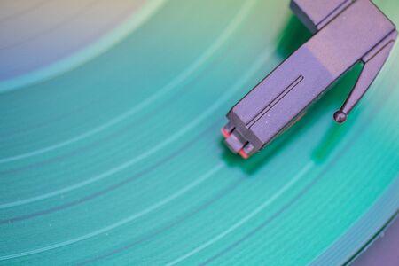 Close up shot of needle on vinyl record