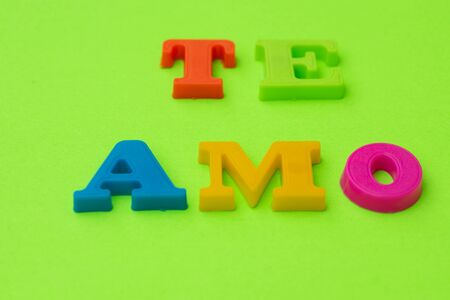 Te amo isolated against colorful background