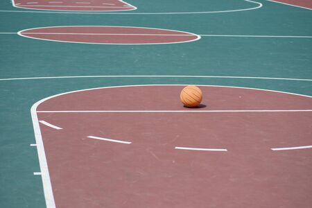 Basketball on court with nobody in sight