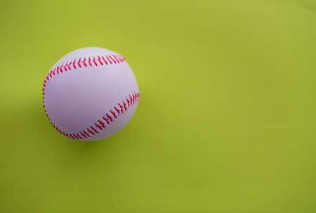 Baseball isolated against lime green background 写真素材