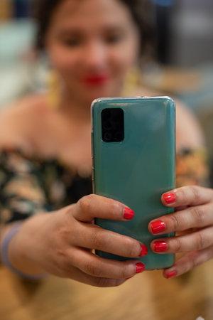 Close up portrait of woman taking a selfie
