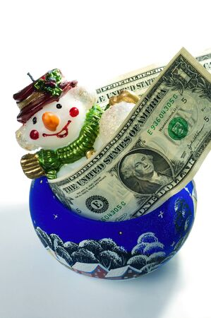Christmas toy snowman in the form candles with dollars   photo
