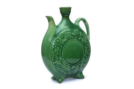 Green glazed water jug in three-quarter position