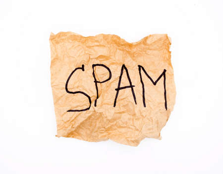 Crumpled paper with the word SPAM  Stock Photo - 19386191